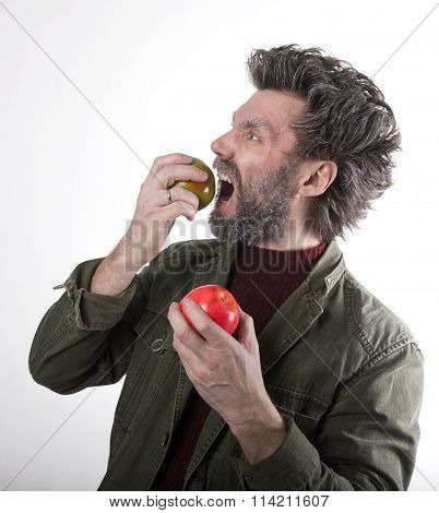 Mr. IceMan, smiling man with a beard, beard covered with hoarfrost, man holding apples, he stares at