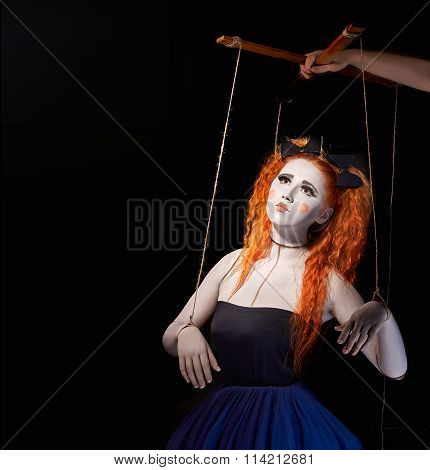 Red-haired girl stylized like marionette puppet