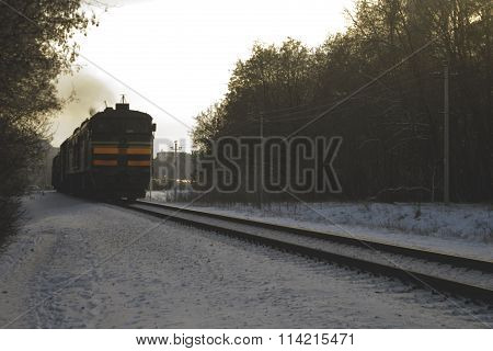 Winter, snow railway freight train, moving out of town