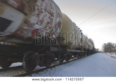 Winter, snow, railway, wagons and tanks in motion