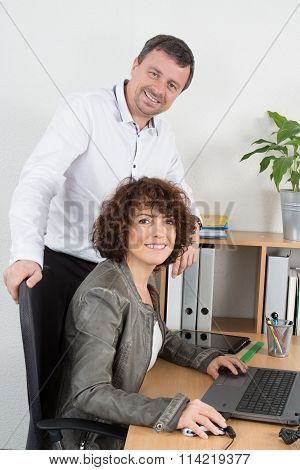 Two Business Partner Working Together In Office Parity
