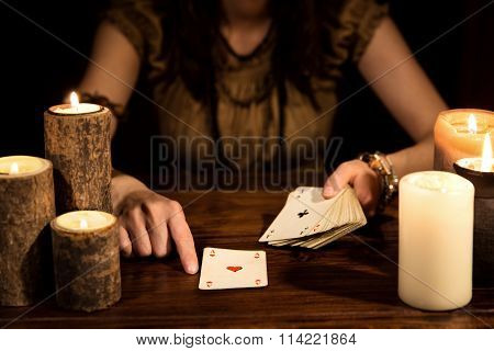 Female Psychic Is Telling The Future With Cards, Concept Tarot And Card Reader