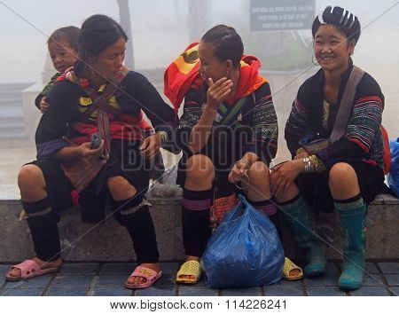 three women are sitting outdoor in Sa Pa, Vietnam
