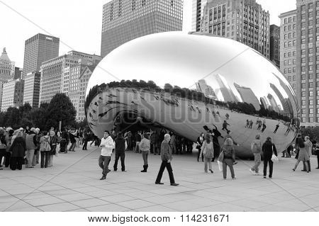 CHICAGO, IL - OCTOBER 02, 2011: Cloud Gate and Chicago skyline. Cloud Gate is the artwork of Anish Kapoor as the famous landmark of Chicago in Millennium Park.
