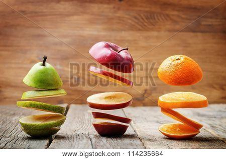Flying Slices Of Fruit: Apple, Pear, Orange