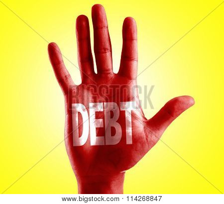 Debt written on hand with yellow background