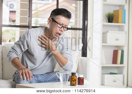 Asian Senior Male In Pain
