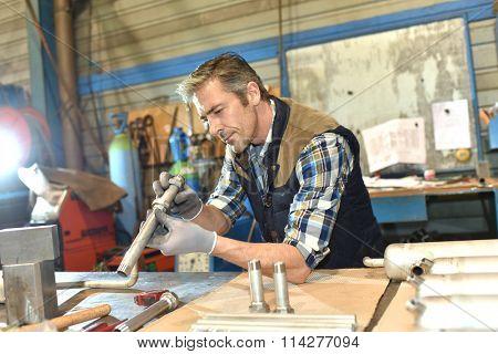 Worker in metallurgy workshop