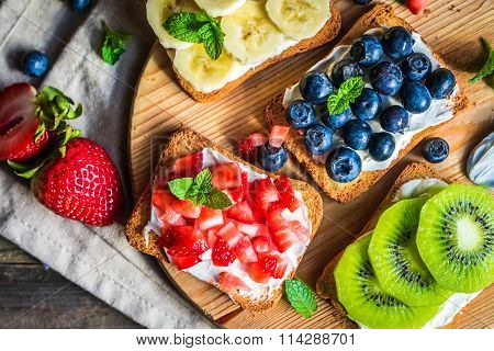Healthy Sandwiches With Fruits On Wooden Background