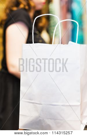 shopping bags standing at the checkout. An empty package