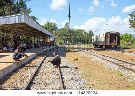 BAGO, MYANMAR - November 16, 2015:  Passengers waiting for the daily train at the train station in Bago Myanmar