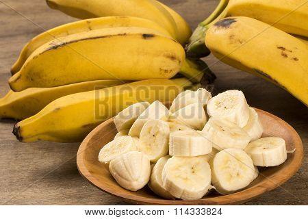 A Banch Of Bananas And A Sliced Banana