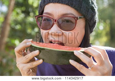 Close Up Face Of Young Woman Earting Water Melon