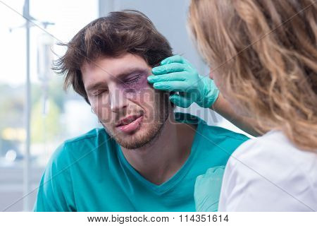 Portrait of male patient with black eye poster