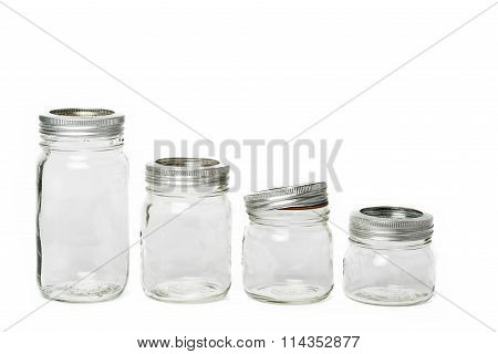 Four Empty Glass Jar