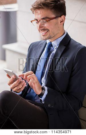 Man Waiting On Railway Station