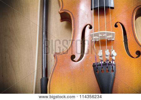 Close up of violin on wooden background
