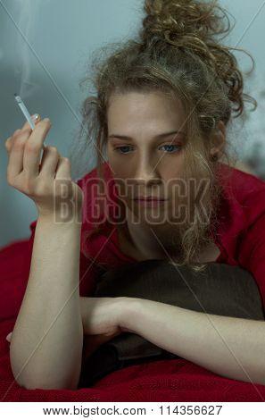 Miserable Woman Smoking Cigarette