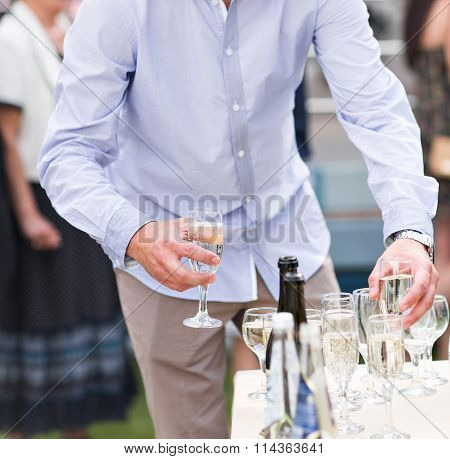 Wedding guest holding glass of champagne closeup