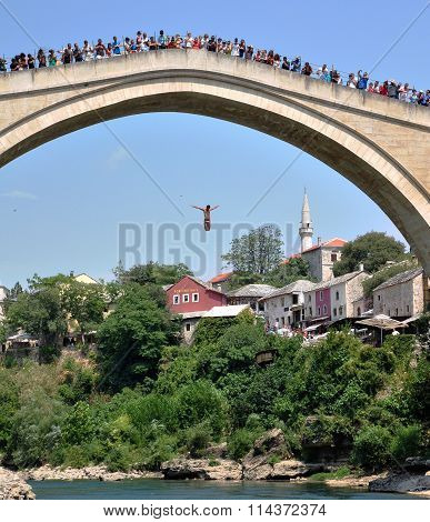 Man Jumping From The Bridge In Old Town Of Mostar