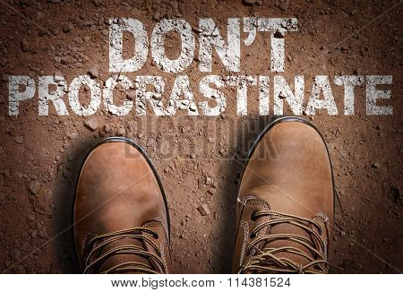 Top View of Boot on the trail with the text: Don't Procrastinate