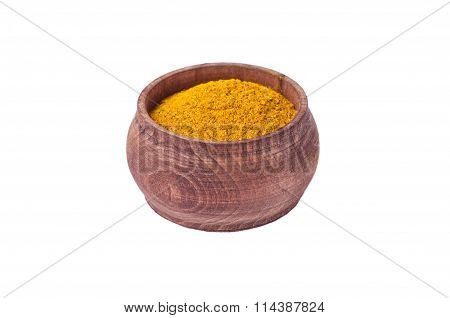 Yellow Curry Powder In Wooden Pot