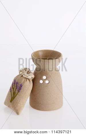 aroma theraphy burner and sachet of lavender  the white background