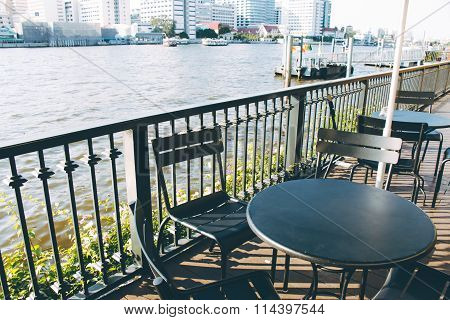Chair Anddesk/ Table Set On The Balcony Besign The River Choa Praya River.