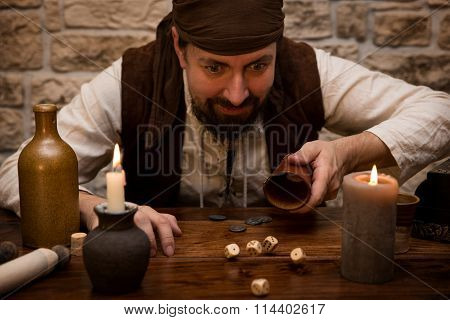 Pirate Is Gambling With Dice On A Medieval Table, Concept Luck And Success