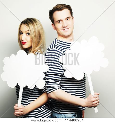amorous couple holding blank paper on stick.
