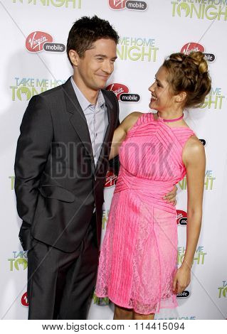 HOLLYWOOD, CALIFORNIA - March 2, 2011. Topher Grace and Teresa Palmer at the Los Angeles premiere of