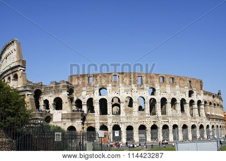 ROME, ITALY- JUNE 2, 2012: Unidentified people by Colloseum in Rome Italy. It is most remarkable landmark of Rome and Italy. The Colosseum is an elliptical amphitheatre in the centre of the city of Rome.