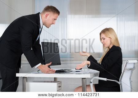 Businessman Blaming Employee In Office