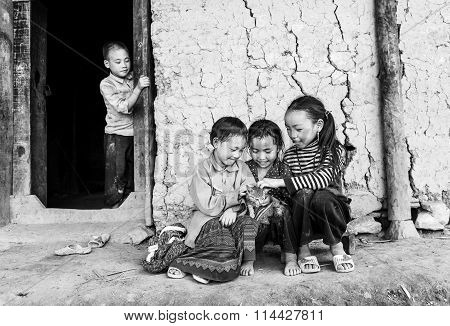 Children from ethnic minorities around with cat