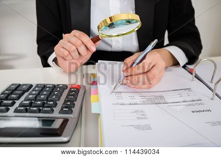 Female Auditor Analyzing Invoice