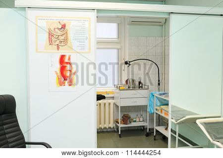 RUSSIA, MOSCOW - AUG 31, 2015: interior of exam room,with informational posters: treatment of motor disorders of digestive tract, riding laboratory stand in Center Endosurgery and Lithotripsy