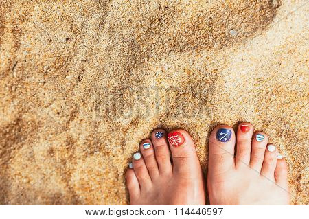 Female Sea Style Pedicured Feet On Summer Shore Sand On Sunny Day