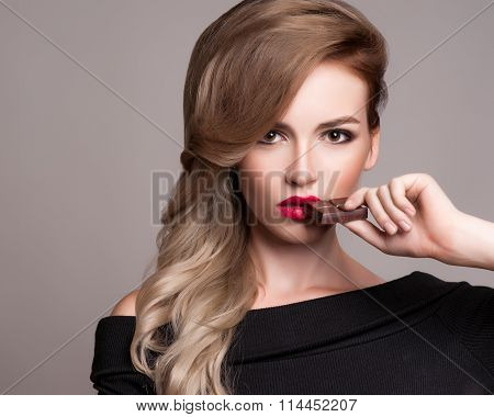 Beauty Fashion Model Girl Eating Chocolate.