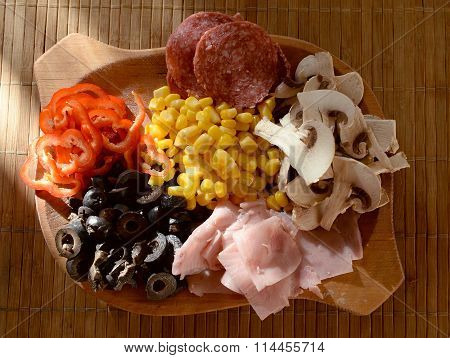 pizza ingredients on a wood board