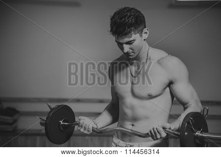 The athlete demonstrates muscles. Work on your body and achieve the goal. Photos for sporting magazines and websites.