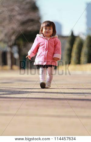 Japanese toddling baby girl (1 year old)