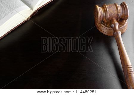 Judges Gavel And Old Book  On The Black Wooden Table