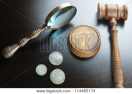 Auctioneers Or Judges Gavel And Old Coins On Black Table
