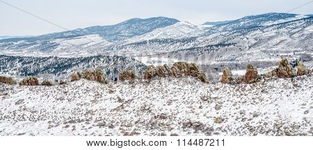 Panorama of Devil's Backbone and Rocky Mountains foothills in cloudy winter scenery, Loveland in northern Colorado