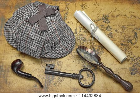 Private Detective Tools On The Old World Map Background. Items Include: Deerstalker Cap, Vintage Magnifying Glass, Manuscript, Smoking Pipe, Old Key. Overhead View poster