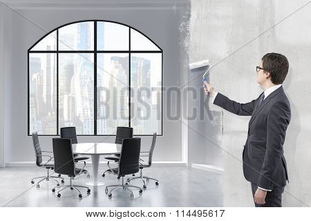Businessman Painting A Room