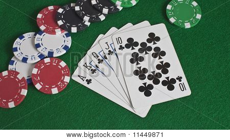 Royal Flush Of Clubs And Poker Chips