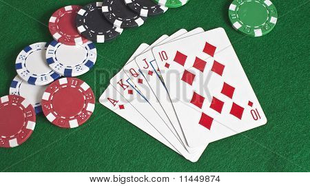 Royal Flush Of Diamonds And Poker Chips