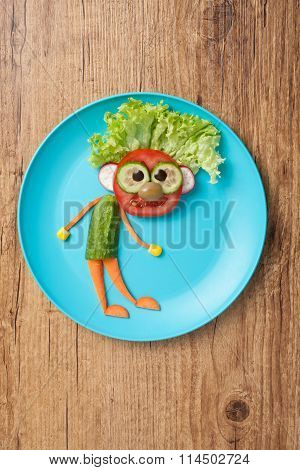 Man Made Of Vegetables On Bule Plate