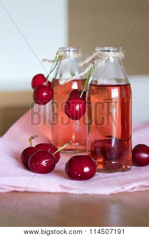 Homemade cherry compote in the glass bottles.